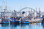 Newport Harbo, Commercial fishing boats, and Yaquina  Bay Bridge, U.S. Highway 101, Pacific Coast Scenic Byway, near Newport, Oregon.  Oregon Central Coast, beaches, bays, bars, family fun, winter storms, lighthouses, fishing boats, bluffs, fossils and beach walks.
