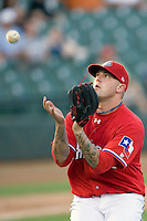 Round Rock Express pitcher Ryan Tucker #55 catches a pop out during a game against the New Orleans Zephyrs at the Dell Diamond on July 20, 2011 in Round Rock, Texas.  New Orleans defeated Round Rock 14-11.  (Andrew Woolley/Four Seam Images)