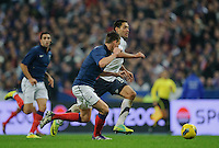 Laurent Konscielny of team France and Clint Dempsey of team USA (l-r) fight for the ball during the friendly match France against USA at the Stade de France in Paris, France on November 11th, 2011.