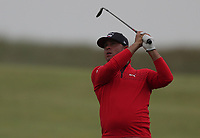 12th July 2021; The Royal St. George's Golf Club, Sandwich, Kent, England; The 149th Open Golf Championship, practice day; Gary Woodland (USA) plays his approach shot tho the 18th green