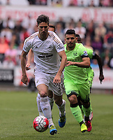 ( L-R ) Federico Fernandez of Swansea City followed by Sergio Aguero of Manchester City during the Swansea City FC v Manchester City Premier League game at the Liberty Stadium, Swansea, Wales, UK, Sunday 15 May 2016