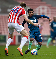 20th March 2021; Bet365 Stadium, Stoke, Staffordshire, England; English Football League Championship Football, Stoke City versus Derby County; Nathan Byrne of Derby County under pressure from  Harry Souttar of Stoke City