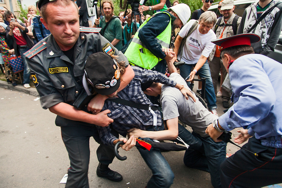 17/08/2012, Moscow, Russia..Police seize protesters outside the court as Maria Alyokhina, Yekaterina Samutsevich and Nadezhda Tolokonnikova of punk band Pussy Riot are sentenced to two years prison for their performance in the Christ The Saviour Cathedral.