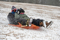 "Lars Panameno, 13, left and Aiden Rios, 12, Ride a sled down what Rios called the ""Full send hill"", Sunday February 14, on a hill  in front of Bethel Baptist Church in Bentonville. Snow is expected to end this morning and another snow fall is expects Wednesday.<br /> (NWA Democrat-Gazette/Spencer Tirey)"