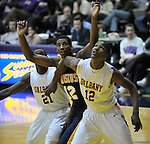 13 December 2008: Albany's Scotty McRae and Canisius' Tomas Vazquez-Simmons battle for position in a game between Canisius and Albany won by Albany 74-46 at SEFCU Arena in Albany, New York.
