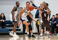WASHINGTON, DC - JANUARY 5: Kyle Lofton #0 of St. Bonaventure sends a pass away from Amir Harris #22 of George Washington during a game between St. Bonaventure University and George Washington University at Charles E Smith Center on January 5, 2020 in Washington, DC.