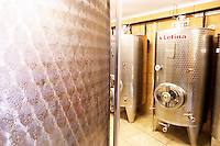 The winery with modern stainless steel fermentation tanks. Toreta Vinarija Winery in Smokvica village on Korcula island. Vinarija Toreta Winery, Smokvica town. Peljesac peninsula. Dalmatian Coast, Croatia, Europe.