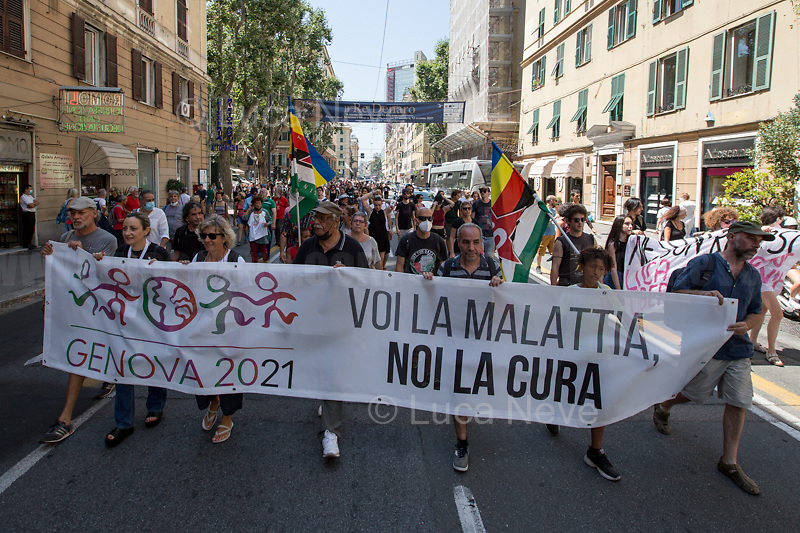 """March from Piazza Matteotti to Piazza Alimonda: from the G8 meeting unaccessable-militarized """"Red Zone"""" To Piazza Carlo Giuliani, Ragazzo (AKA Piazza Alimonda).<br /> <br /> Genoa, Italy. 19, 20, 21 July 2021. Twenty years after the dramatic and terrifying events related to the 2001 Genoa's G8 meeting, according to Amnesty International: """"the most serious suspension of democratic rights in a Western country since the Second World War"""" (1.) and as stated on the 2001 """"Report on the situation of fundamental rights in the EU"""" the European Parliament """"deplores the suspensions of fundamental rights that took place during public demos, and in particular at the G8 meeting in Genoa, such as freedom of expression, freedom of movement, the right to physical integrity"""" (2.). As a reminder, the City of Genoa is State Gold Medal (Medaglia D'Oro) for its Antifascist Resistance in World War II.<br /> Some photos, part of this story, are presented appositely in Black & White to show to the audience """"the Places"""" where the majority of - the already mentioned (see above) - """"suspensions of fundamental rights […] such as freedom of expression, freedom of movement, the right to physical integrity"""" (2.) happened.<br /> In these three days, throughout a series of events, Genoa and its People, survivors and witnesses, experts and activists, remembered what happened 20 years ago, discussed the...<br /> <br /> FULL CAPTION AT THE BEGINNING OF THIS STORY.<br /> <br /> Footnotes, Links, Sources:<br /> <br /> 1. http://bit.do/fRvdg<br /> 2. http://bit.do/fRvdi<br /> 3. http://bit.do/fRvdj<br /> 4. http://bit.do/fRvdn<br /> 5. http://bit.do/fRvdo<br /> 6. http://bit.do/fRvdr<br /> 7. http://bit.do/fRvdt & http://bit.do/fRvdu<br /> 8. http://bit.do/fRvdv & http://bit.do/fRvdw & http://bit.do/fRvdx<br /> 9. http://bit.do/fRvdz<br /> 10. http://bit.do/fRvdA<br /> 11. http://bit.do/fRvdB<br /> http://www.veritagiustizia.it/doc_eng/<br /> https://www.carlogiuliani.it<br /> https://en.wikipedia.org/wiki"""