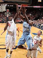 Jan. 8, 2011; Charlottesville, VA, USA;  North Carolina Tar Heels forward Harrison Barnes (40) is defended by Virginia Cavaliers center Assane Sene (5) during the game at the John Paul Jones Arena. North Carolina won 62-56. Mandatory Credit: Andrew Shurtleff