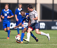 Eric Labourdette (6) of Georgetown fights for the ball with Kai Greene (8) of Seton Hall during the game at Shaw Field in Washington, DC.  Georgetown defeated Seton Hall, 8-0.