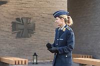 """Auf dem Gelaende des Einsatzfuehrungskommando der Bundeswehr, der Henning-von-Tresckow-Kaserne bei Potsdam, wurde ein Ehrenhain zum Gedenken an die im Einsatz verstorbenen Bundeswehrangehoerigen eingerichtet. In diesem """"Wald der Erinnerunge"""" sind die Gedenkhaine aus den Einsatzgebieten der Bundeswehr errichtet worden. Zum Teil originalgetreu nachgebildet von den Orten in denen die Bundeswehr eingesetzt war und Angehoerige verstorben sind.<br /> Im Bild: Oberleutnant der Luftwaffe Seidenschwanz vor dem """"Ort der Stille"""".<br /> 14.11.2014, Potsdam<br /> Copyright: Christian-Ditsch.de<br /> [Inhaltsveraendernde Manipulation des Fotos nur nach ausdruecklicher Genehmigung des Fotografen. Vereinbarungen ueber Abtretung von Persoenlichkeitsrechten/Model Release der abgebildeten Person/Personen liegen nicht vor. NO MODEL RELEASE! Don't publish without copyright Christian-Ditsch.de, Veroeffentlichung nur mit Fotografennennung, sowie gegen Honorar, MwSt. und Beleg. Konto: I N G - D i B a, IBAN DE58500105175400192269, BIC INGDDEFFXXX, Kontakt: post@christian-ditsch.de<br /> Urhebervermerk wird gemaess Paragraph 13 UHG verlangt.]"""