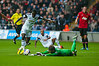 Saturday 17 August 2013<br /> <br /> Pictured: Nathan Dyer of Swansea tries to get the ball past keeper David de Gea of Manchester United<br /> <br /> Re: Barclays Premier League Swansea City v Manchester United at the Liberty Stadium, Swansea, Wales