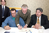 Feb 14, 2002, Montreal, Quebec, Canada; <br /> <br /> Wemindji Exploration Inc Manager and Exploration Director ; Claude Jacques (L) <br /> Dianor Inc President;  John Ryder (M),  and<br /> Canadian Cree  leader Dr. Ted Moses (R)<br /> sign a partnership deal for diamond exploration and mining in the James Bay area of Northen Quebec.<br /> Feb 14, 2002, , in Montreal, Canada.<br /> <br /> Rights and profits will be shared equally between Dianor Inc and Cree indian owned Weminji Exploration Inc.<br /> <br /> Dianor ticker symbol is DOR : CDNX<br /> <br /> (Mandatory Credit: Photo by Sevy - Images Distribution (©) Copyright 2002 by Sevy<br /> <br /> NOTE :  D-1 H original JPEG, saved as Adobe 1998 RGB.