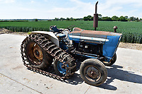 BNPS.co.uk (01202) 558833. <br /> Pic: Cheffins/BNPS<br /> <br /> Pictured: A Ford 3000 half-track tractor sold for £4900. <br /> <br /> A farming family is today celebrating after their incredible collection of almost 100 vintage tractors sold for a staggering £1million.<br /> <br /> Father and son duo Ian and Martin Liddell began hoarding the agricultural vehicles at their arable farm in the 1980s.<br /> <br /> Their fleet of tractors was so large that they had to be stored in three barns.<br /> <br /> The prized collection sparked a worldwide bidding war when it was sold with auctioneers Cheffins, of Cambridge, after the family decided to part with the tractors to free up space on their Essex farm to pursue other projects.