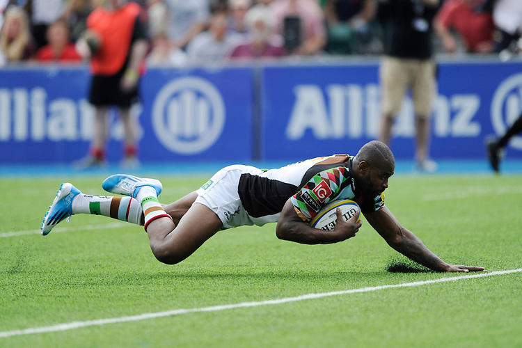 Ugo Monye of Harlequins dives over to score a try during the Aviva Premiership semi final match between Saracens and Harlequins at Allianz Park on Saturday 17th May 2014 (Photo by Rob Munro)