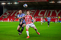 16th February 2021; Bet365 Stadium, Stoke, Staffordshire, England; English Football League Championship Football, Stoke City versus Sheffield Wednesday; Tom Lees of Sheffield Wednesday defends from James McClean of Stoke City