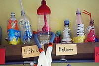 Shelf of articles built by students to explain the properties of Lithium and Helium, Science dept., state Secondary School.