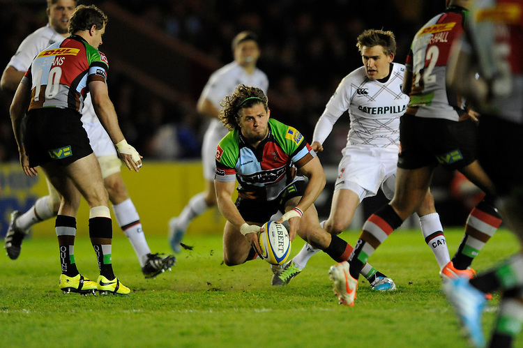 Luke Wallace of Harlequins passes during the Aviva Premiership match between Harlequins and Leicester Tigers at the Twickenham Stoop on Friday 18th April 2014 (Photo by Rob Munro)