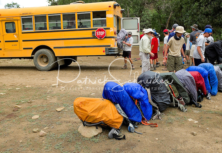 Photo story of Philmont Scout Ranch in Cimarron, New Mexico, taken during a Boy Scout Troop backpack trip in the summer of 2013. Photo is part of a comprehensive picture package which shows in-depth photography of a BSA Ventures crew on a trek. In this photo a BSA Venture Crew works to unload their backpacks being dropped off in the backcountry for the start of the trek at the Philmont Scout Ranch. <br /> <br /> Photo by travel photograph: PatrickschneiderPhoto.com