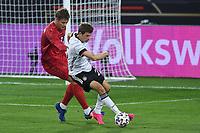 2nd June 2021, Tivoli Stadion, Innsbruck, Austria; International football friendly, Germany versus Denmark;  Thomas Muller Germany holds off Jannik Vestergaard Denmark