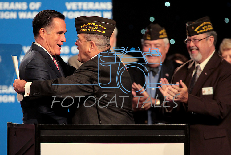 Republican presidential candidate Mitt Romney greets Veterans of Foreign Wars Commander Richard De Noyer before his speech at the convention in Reno, Nev., on Tuesday, July 24, 2012..Photo by Cathleen Allison