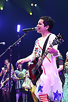 The Go-Go's:  Jane Wiedlin performs with the cast during a special curtain call at Broadway's 'Head Over Heels' on July 12, 2018 at the Hudson Theatre in New York City.