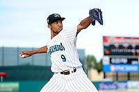 Jupiter Hammerheads pitcher Angel Sanchez (9) warms up in the bullpen before a game against the Tampa Yankees on July 17, 2013 at Roger Dean Stadium in Jupiter, Florida.  Jupiter defeated Tampa 4-3.  (Mike Janes/Four Seam Images)