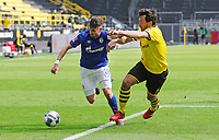 16th May 2020, Signal Iduna Park, Dortmund, Germany; Bundesliga football, Borussia Dortmund versus FC Schalke;   FC Schalke's Daniel Caligiuri holds off  BVB Mats Hummels