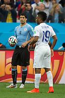 Luis Suarez of Uruguay and Liverpool team mate Raheem Sterling of England