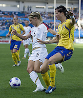 USA forward (5) Lindsay Tarpley and Sweden midfielder (8) Charlotta Schelin. The USA defeated Sweden 2-0 during their Group B first round game at the 2007 FIFA Women's World Cup at Chengdu Sports Center Stadium in Chengdu, China on September 14, 2007.