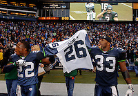 Oct 23, 2005; Seattle, Wash, USA;  Seattle Seahawks cornerback #22 Jimmy Williams and safety #33 Marquand Manuel hold the jersey of safety #26 Ken Hamlin, who was injured in a bar fight in downtown Seattle last week, after the Seahawks defeated the Dallas Cowboys at Qwest Field. Mandatory Credit: Photo By Mark J. Rebilas