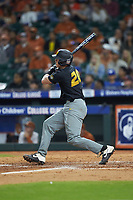 Chad McDaniel (20) of the Missouri Tigers follows through on his swing against the Texas Longhorns in game eight of the 2020 Shriners Hospitals for Children College Classic at Minute Maid Park on March 1, 2020 in Houston, Texas. The Tigers defeated the Longhorns 9-8. (Brian Westerholt/Four Seam Images)