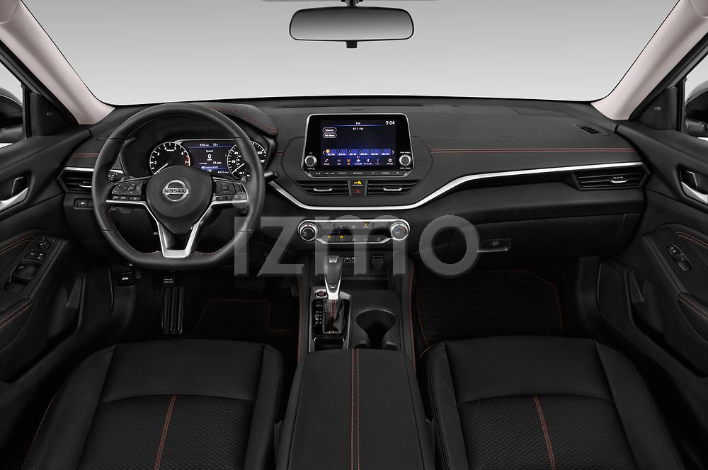 Stock photo of straight dashboard view of 2020 Nissan Altima SR-FWD 4 Door Sedan Dashboard