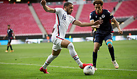ZAPOPAN, MEXICO - MARCH 21: Hassani Dotson #18 of the United States dribbles with the ball during a game between Dominican Republic and USMNT U-23 at Estadio Akron on March 21, 2021 in Zapopan, Mexico.