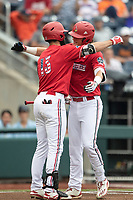 Louisville Cardinals shortstop Tyler Fitzgerald (2) is greeted at the plate by teammate Alex Binelas (13) after hitting a first inning home run during Game 7 of the NCAA College World Series against the Auburn Tigers on June 18, 2019 at TD Ameritrade Park in Omaha, Nebraska. Louisville defeated Auburn 5-3. (Andrew Woolley/Four Seam Images)
