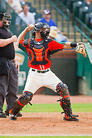 Greensboro Grasshoppers catcher Tony Caldwell (29) throws the ball back to his pitcher during the South Atlantic League game against the Augusta GreenJackets at NewBridge Bank Park on August 11, 2013 in Greensboro, North Carolina.  The GreenJackets defeated the Grasshoppers 6-5 in game one of a double-header.  (Brian Westerholt/Four Seam Images)