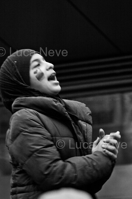 Protester - 2011<br /> <br /> London, 23/02/2011. Libyan people protested peacefully outside the US embassy urging the US Government to implement the No-Fly Zone in Libya and to stop the massacre of Libyan civilians by Gaddafi forces. At the end of the demonstration, the protesters burned editions of Gaddafi's Green Books and the Green Flag imposed by the dictator as the Libyan national flag.