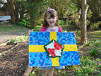Pictured: Elly Neville with the flag she created circa 2009 <br /> Re: Seven-year-old Elly Neville who was born despite doctors saying her parents would not be able to have any more children, has raised over £150,000 for the cancer ward that treated her father.<br /> Her parents Lyn and Ann had been told they were unlikely to have more children after he underwent a bone marrow transplant in 2005. <br /> Mr Neville subsequently spent a lot of time on the Ward 10 cancer facility at Withybush Hospital in Haverfordwest, Pembrokeshire.<br /> But four years later they were stunned when his painter and decorator wife Ann fell pregnant again.