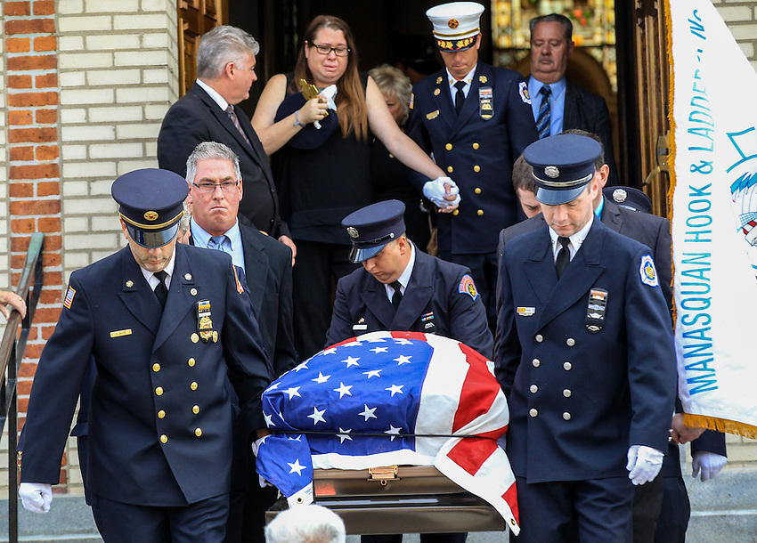 The flag-draped casket containing the remains of Manasquan volunteer firefighter Dan McCann is carried out of St. Cecilia's Church after McCann's funeral mass. McCann died last week after a fire department training exercise.  9/21/16  (Andrew Mills   NJ Advance Media for NJ.com)