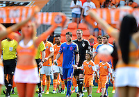 April 28, 2013: Colorado Rapids defender Drew Moor #3 and a young boy dressed in Houston Dynamo uniform lead the team on to the field before Major League Soccer match in Houston  TX. Houston Dynamo draw 1-1 against Colorado Rapids.