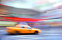 New York Yellow cab ,blurred travelling through Times Square.photo by Geraint Lewis