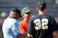 Miami Hurricanes head coach Jim Morris #3 and Wake Forest Demon Deacons head coach Tom Walter #32 meet with home plate umpire Gregory Street prior to the game at Gene Hooks Field on March 19, 2011 in Winston-Salem, North Carolina.  Photo by Brian Westerholt / Four Seam Images