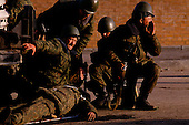 Moscow, Russia.October 4, 1993..Russian troops, near the US Embassy surround the Parliament building in hopes of removing hundreds of well armed anti-Yeltsin demonstrators held up inside. ..Russian soldiers call to evacuate a seriously wounded soldier after an anti-Yeltsin sniper, held up in the Parliament build, fired a round of bullets onto them.
