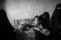 October 10th 2012 in Attorba village. Mothers living closeby gather inside Hend Mohammed's  house to show their sick children. Hend (18), is the mother of Rahaf, a severely malnourished 1 year old girl. She is pregnant and also has a 2 year old son.<br /> <br /> Attorba is a tiny village of the very populated and impoverished Bayt al-Faqih district in Yemen which receives humanitarian aid from the international NGO's that operate in the area.