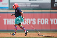 """A member of the """"Molly Maids"""" drags the infield between innings of the game between the Bowie Baysox and the Richmond Flying Squirrels at The Diamond on July 28, 2021, in Richmond Virginia. (Brian Westerholt/Four Seam Images)"""