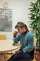 "Switzerland. Canton Ticino. Mendrisio. Fondazione Diamante. Gaia Mereu (C) works two days a week at ""Il Punto"" which is a protected laboratory offering adults with moderate working skills or disabilities an opportunity to carry out production activities in a protected environment.  Coffee break. Gaia Mereu is a dancing member of MOPS_DanceSyndrome which is an independent Swiss artistic, cultural and social organisation operating in the field of contemporary dance and disability. It is composed only of Down dancers. Down syndrome (DS or DNS), also known as trisomy 21, is a genetic disorder caused by the presence of all or part of a third copy of chromosome 21 It is usually associated with physical growth delays, mild to moderate intellectual disability, and characteristic facial features. 10.02.2020 © 2020 Didier Ruef"