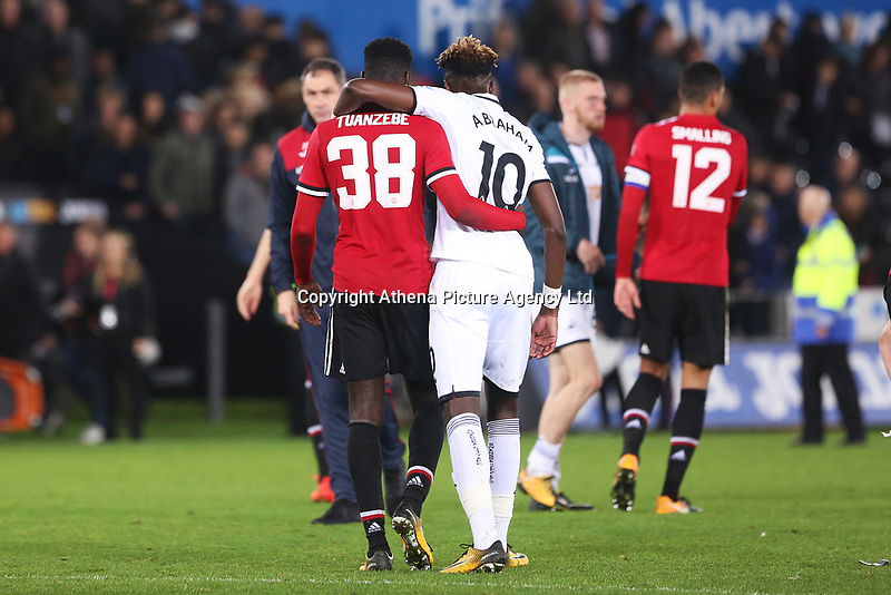 Axel Tuanzebe of Manchester United and Tammy Abraham of Swansea City after the final whistle of the Carabao Cup Fourth Round match between Swansea City and Manchester United at the Liberty Stadium, Swansea, Wales, UK. Tuesday 24 October 2017