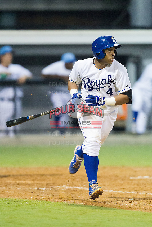Xavier Fernandez (4) of the Burlington Royals tosses his bat as he starts down the first base line during the game against the Princeton Rays at Burlington Athletic Park on July 9, 2014 in Burlington, North Carolina.  The Rays defeated the Royals 3-0.  (Brian Westerholt/Four Seam Images)