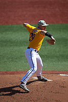 East Carolina Pirates starting pitcher Jake Kuchmaner (29) makes a pick-off throw to first base against the Charlotte 49ers at Hayes Stadium on March 8, 2020 in Charlotte, North Carolina. The Pirates defeated the 49ers 4-1. (Brian Westerholt/Four Seam Images)