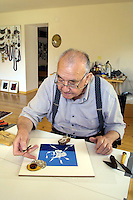 Switzerland. Canton of Graubunden. Cabbiolo. The swiss artist Daniel Spoerri works at home on a new work of art. © 2004 Didier Ruef